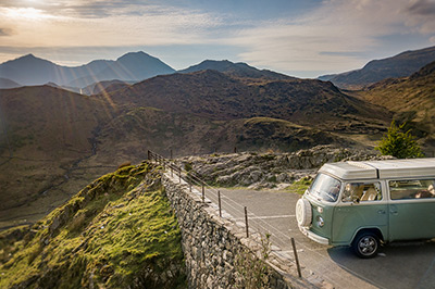 Bessie our 1973 VW classic retro Bay window Type 2 (T2) camper van for hire in Nant Gwynant Pass with Snowdon in the background