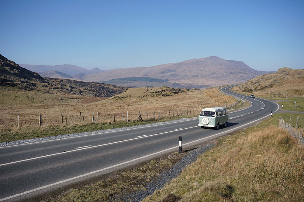 campervan Bessie on a roadtrip on the Crimea Pass, Wales